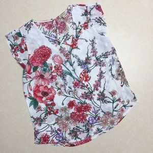 Lily White floral blouse cap sleeve criss cross